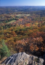 View from Lions Head in Connecticut, part of the Appalachian Trail, showing a mosaic of hills, forests, and farms in autumn. Photo by John Burk.