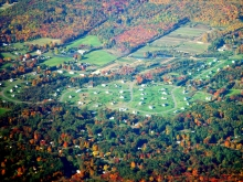 Developed landscape with trees showing fall foliage