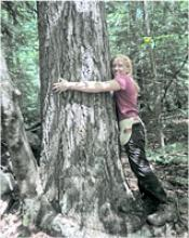 REU student Kate Eisen with tree