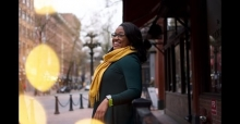 Tiffany Carey stands smiling on a city street