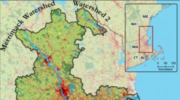 map of the Merrimack River watershed, showing forests in green and developed areas in red
