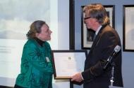 Laurie Patton receiving an award