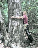 REU student Kate Eisen with tree