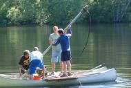 A group pond coring on canoes