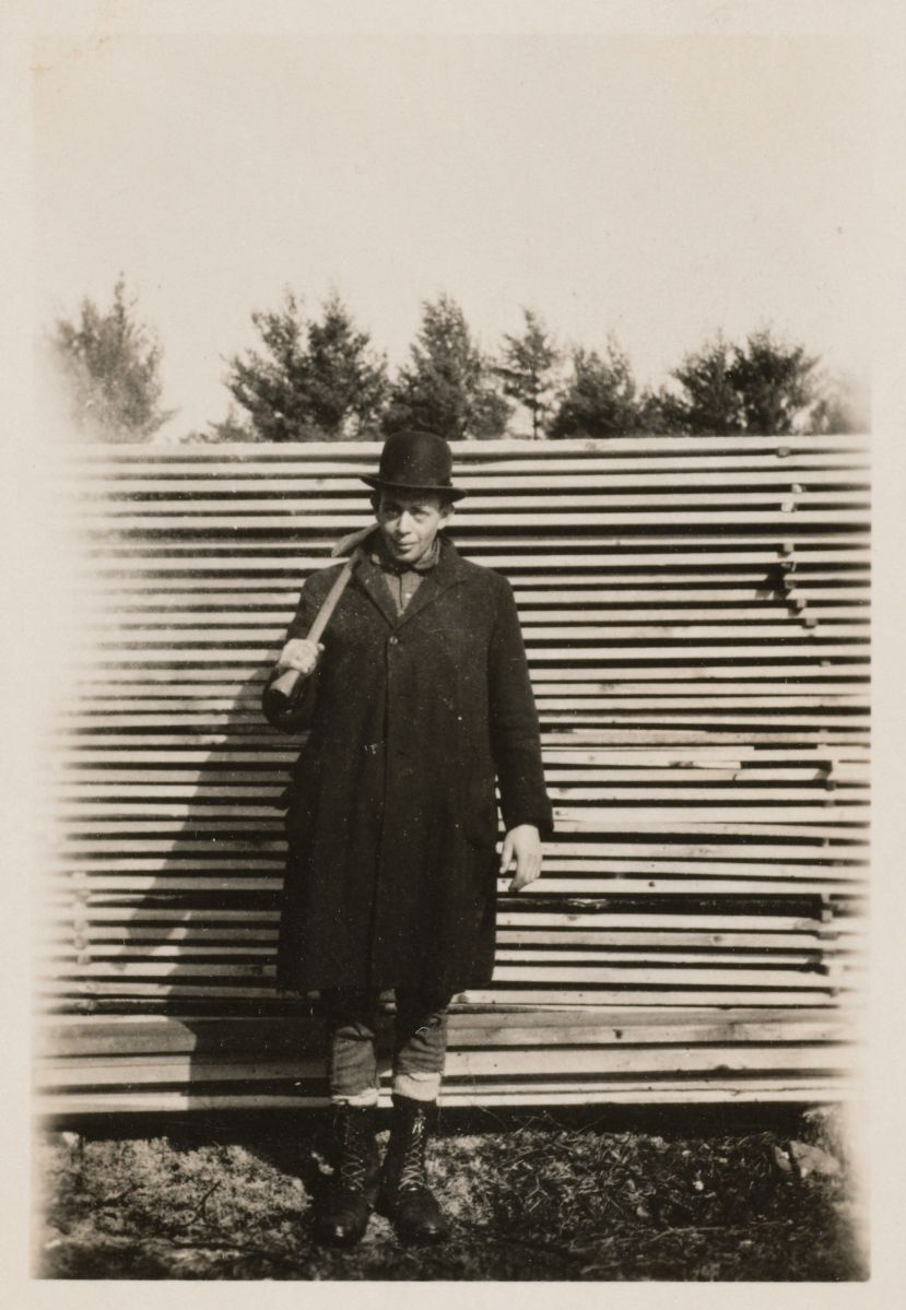 Bob Marshall in front of stacked lumber