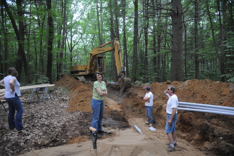 [Construction of the chamber array has involved installation of new infrastructure. For example, a new, underground primary electric line had to be run from Locust Opening Road to the chamber site. Shown here are (left to right) data analyst Liza Nicoll, Director of Administration Edythe Ellin, and our two electricians (Neil Hampson on the right).]