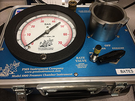 "[Pressure chamber, a.k.a ""pressure bomb,"" used to measure the water potential of leaves.]"