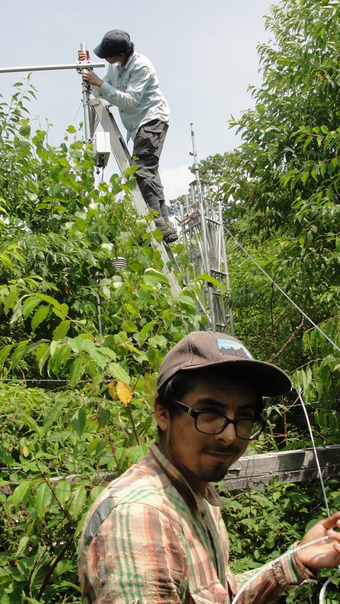 [Josh Alaniz with his mentor, Dr. Christopher Williams, working on an eddy-flux tower.]