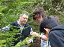 HF forest ecologist Dave Orwig shows hemlock woolly adelgid to high schoolers