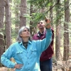 Schoolyard coordinator Pam Snow works with a teacher on the nature trail